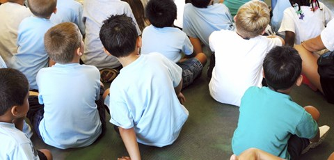 Primary children sitting