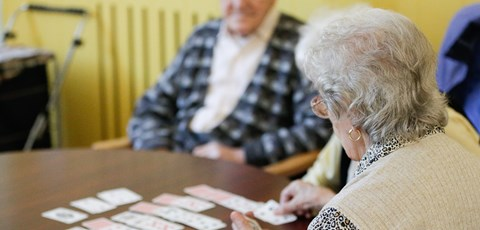 Elderly playing cards