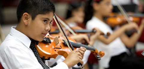 Young boy playing the violin